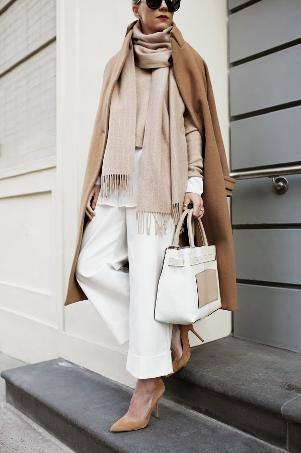 Neutral Outfit: Blair Eadie is wearing white trousers from Philip Lim,  brown shoes from