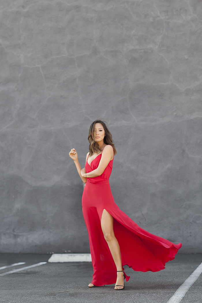 Aimee Song is wearing a red cut-out dress with high slits from Vatanika