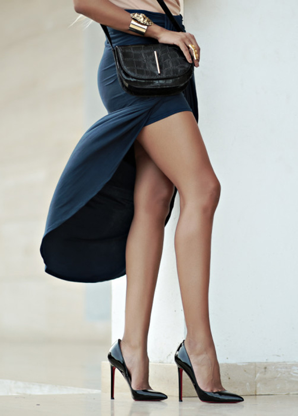 Dawilda Gonzalez is wearing a high slit blue skirt