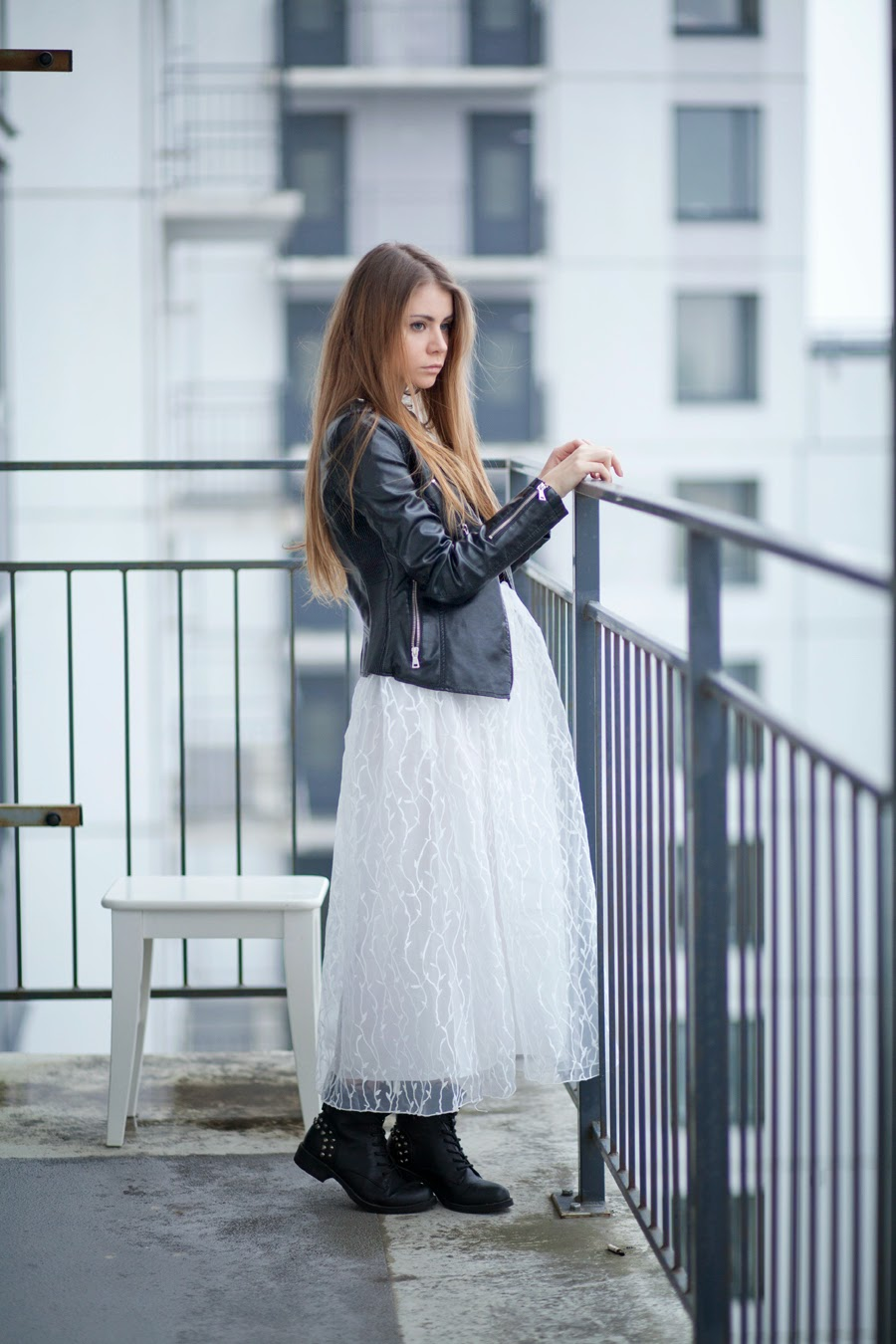 Anna Vershinina is wearing a white lace dress from Sheinside, leather jacket from Style Moi and the shoes are from Incity