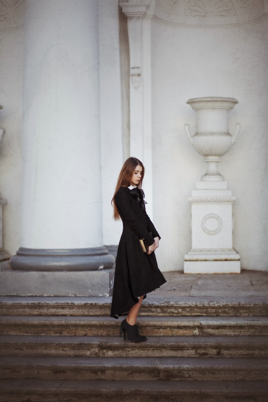 Anna Vershinina is wearing a black coat from Zaful, matching skirt from Sheinside and the white blouse is from OASAP
