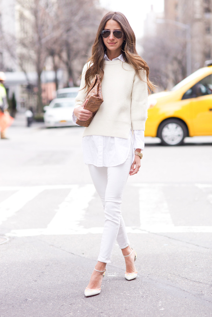 Arielle Nachami is wearing all white, jeans and sweater both from AYR, shirt from H&M, shoes from Charlotte Olympia and the bag is from Marie Turnor