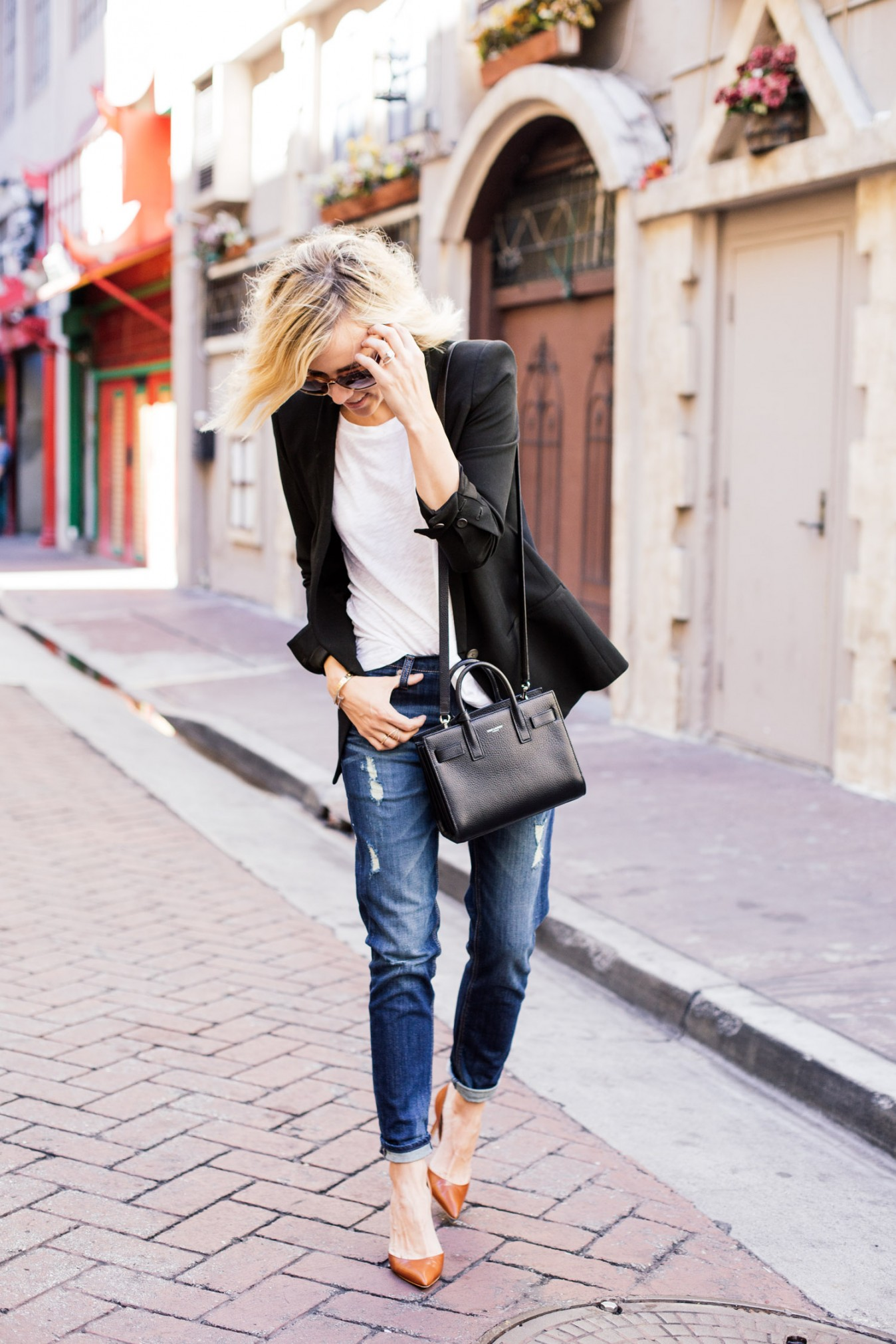 Jacey Duprie is wearing a white T-shirt and distressed girlfriend jeans from Express, blazer from Helmut Lang, and the shoes are from Manolo Blahnik