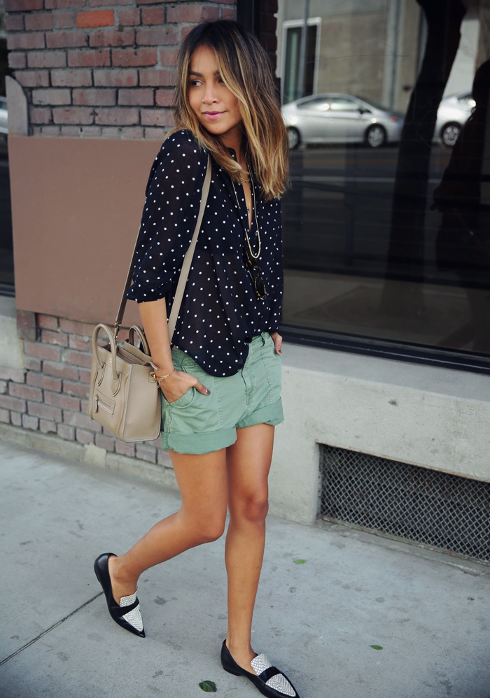 Street Style 2015: Julie Sarinana is wearing a blue shirt with white dots and fatigue shorts from Madewell, and the pointy flats are from Celine