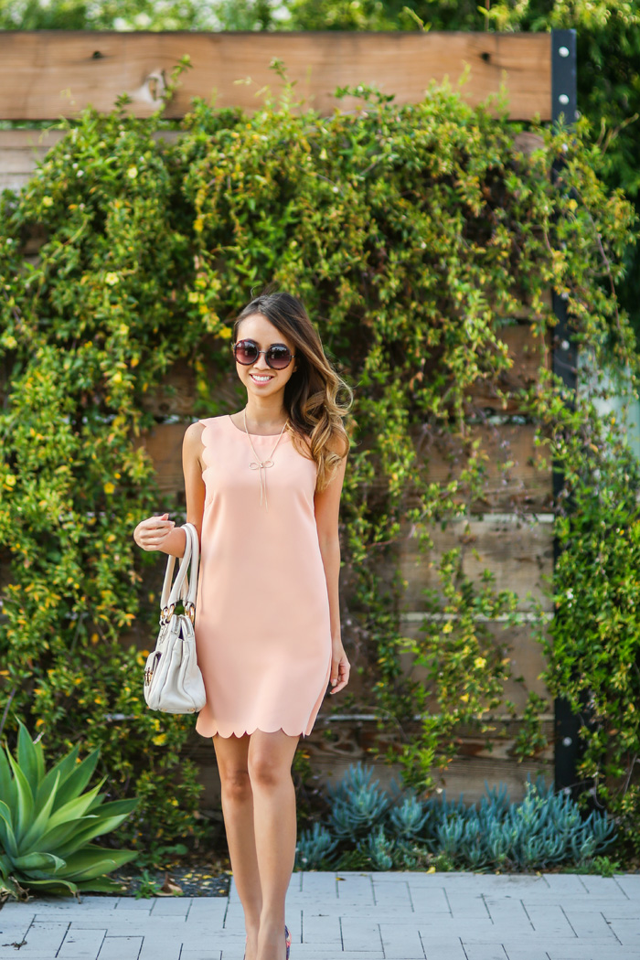 Street Style, March 2015: Kim Le is wearing a peach pink Urban Outfitters dress with Nordstrom sunglasses and a Marc Jacobs handbag