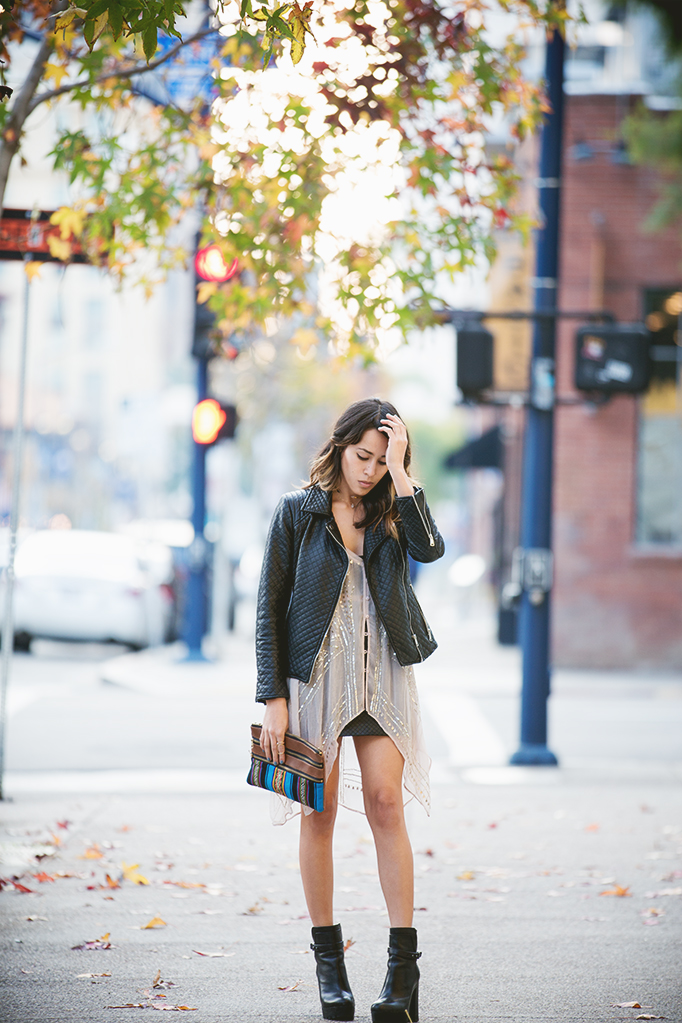 Just The Design: Fransesca Felix is wearing a sheer tunic from Urban Outfitters, a black Forever 21 jacket with Pour la victoire ankle boots