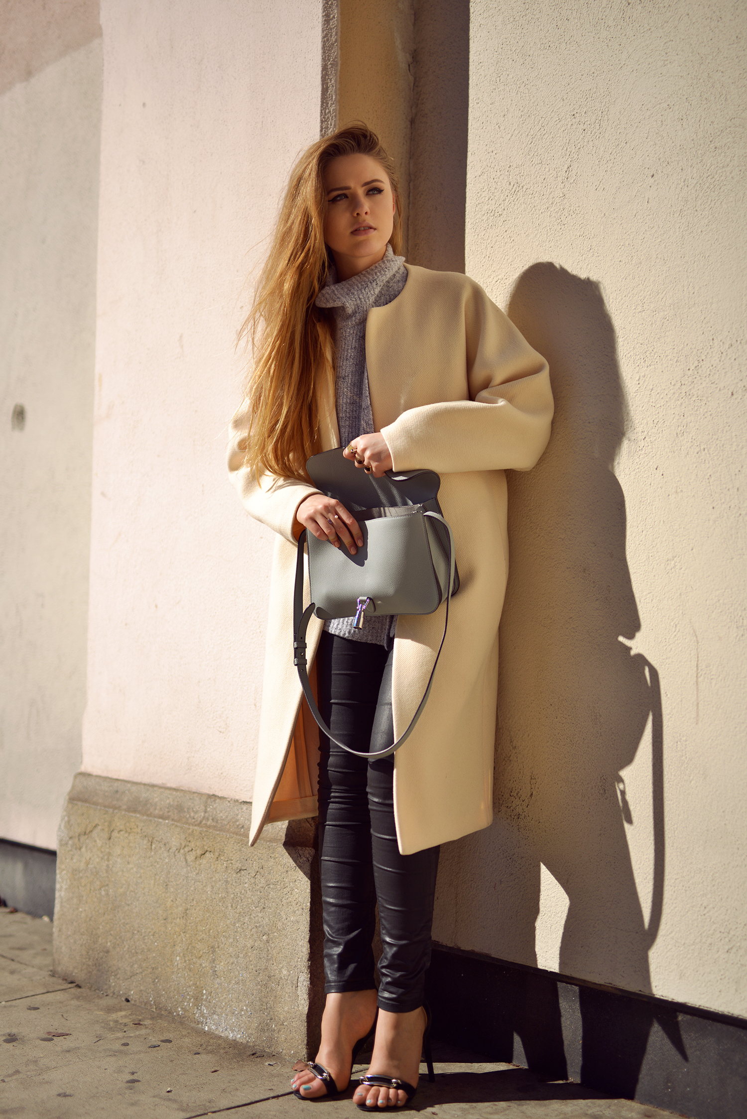 Street Style, March 2015: Kristina Bazan is wearing a creme Chloé coat with black Zara leather trousers and a pair of Balenciaga heels