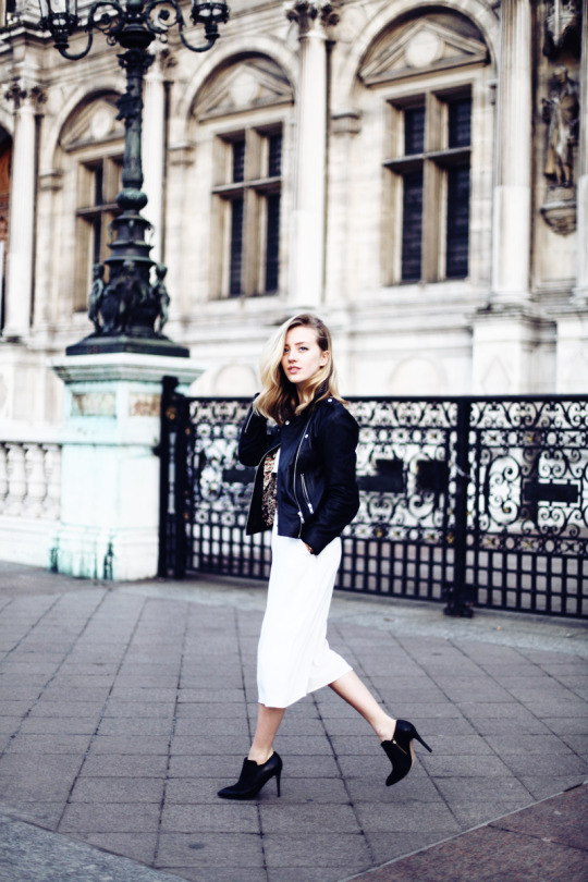 Sarah Mikaela is wearing a Reiss black lather jacket and ankle boots with a pair of white Oasis culottes