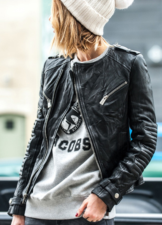 Street Style March 2015: Anine Bing is wearing a black leather jacket from Anine Bing, a grey Tres-Click sweatshirt with a white knitted beanie