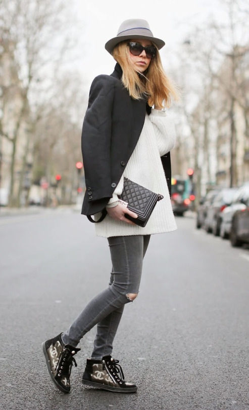 Street Style, March 2015: Caroline Louis is wearing a black Vanessa Bruno blazer with an oversized white knitted sweater, Topshop skinny jeans and Chanel sneakers