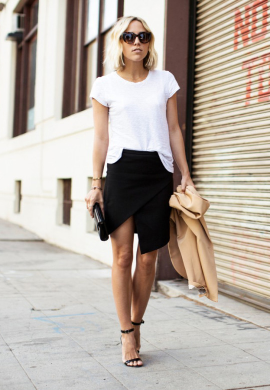 High Slit Skirts: Jacey Duprie is wearing a black Asymmetric wrap skirt