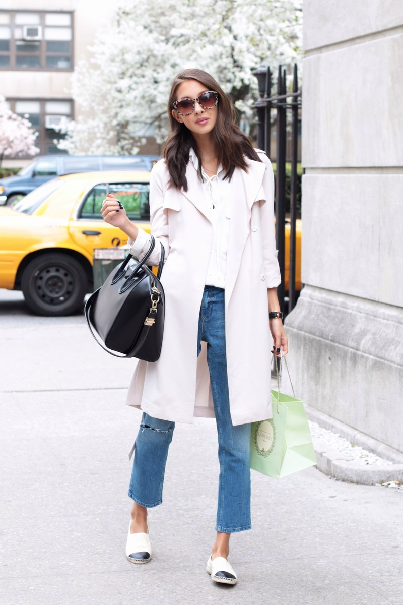 Street Style 2015: Felicia Akerstrom is wearing a pastel pink H&M mac coat with a pair of denim Asos jeans, a Zara white blouse, Chanel pumps and a black Givenchy handbag