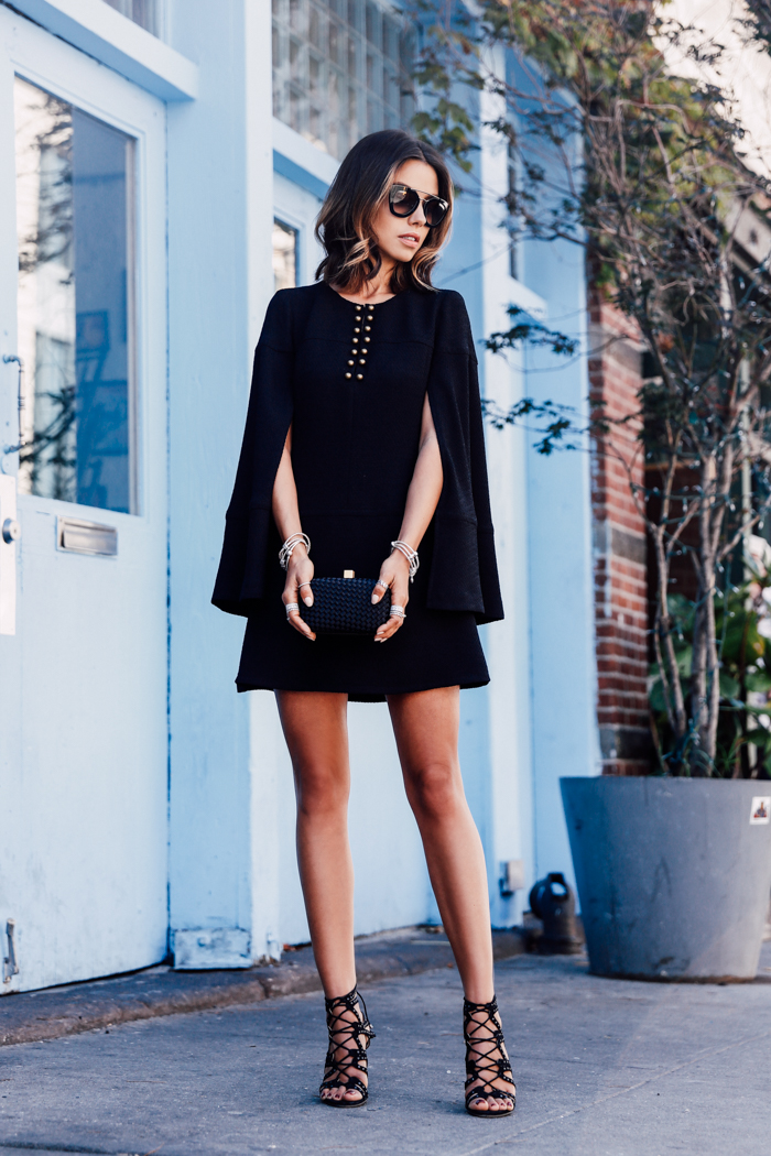 Annabelle Fleur is rocking this black mini dress with edgy heeled sandals. Dress: Nanette Lepore, Sandals: Chelsea Paris.