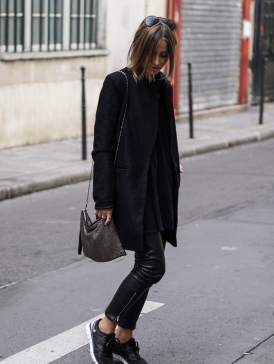 Leather trousers and monochrome sneakers make the perfect all black ensemble. We recommend Camille Callen's style of wearing the two with a simple black overcoat and a pair of shades. Trousers: Mango, Sneakers: Nike Free Run, Coat: Sheinside.