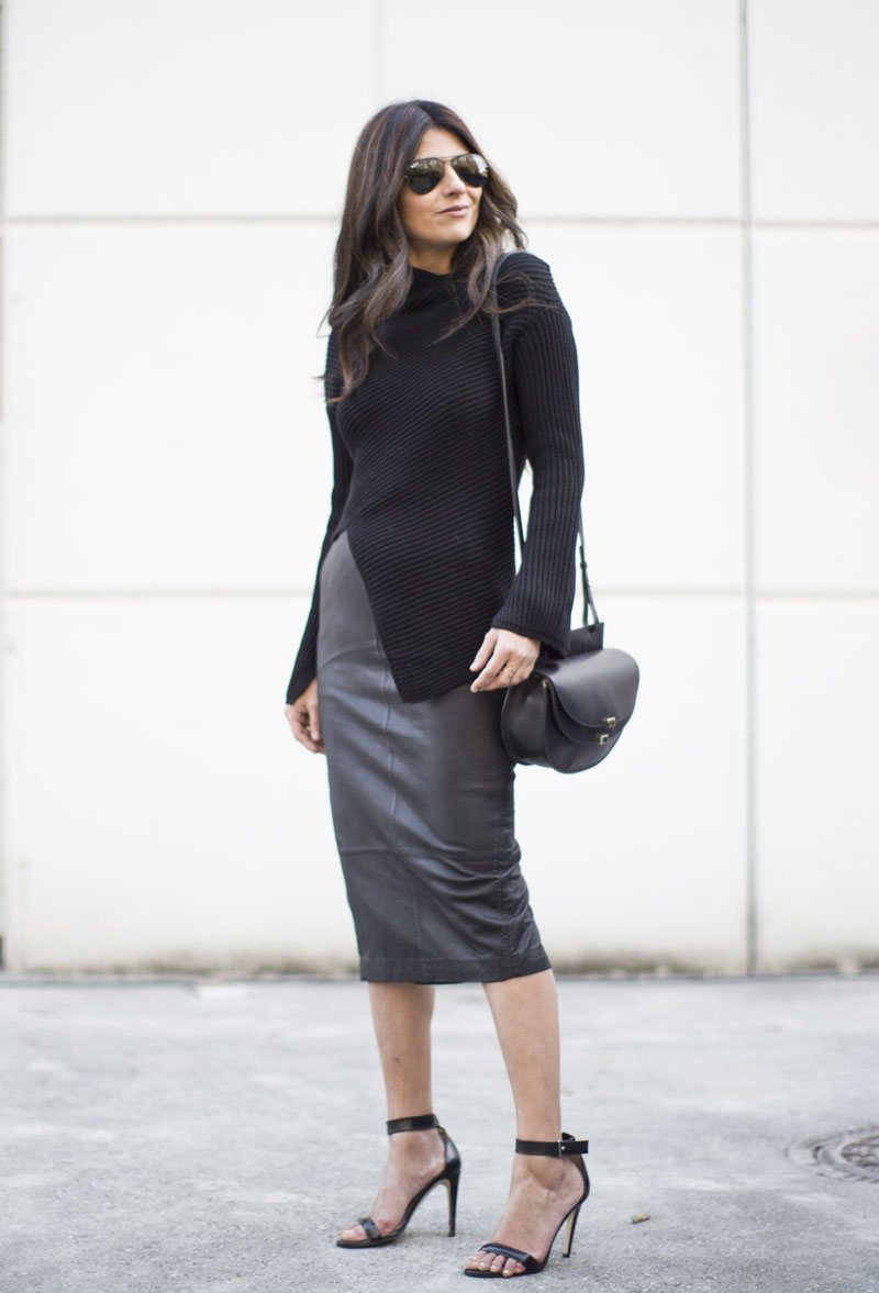 Laura Dittrich keeps in theme with the all black trend in this gorgeous leather pencil skirt and slit detailed black knit top. This look is both simple and highly sophisticated; a great look for the new year! Sweater: Joseph, Sandals: Mode Collective, Skirt: ASOS, Coat: H&M, Bag: Chloé.