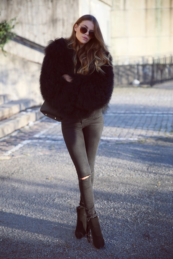 Another quirky way to wear the all black trend is through a black fluffy coat, such as this one worn by Josefin Ekström. Pair a statement coat with skinny black denim and ankle boots to recreate this look. Jacket: Pellobello, Top: IMSO, Shoes: Fashion Nova.