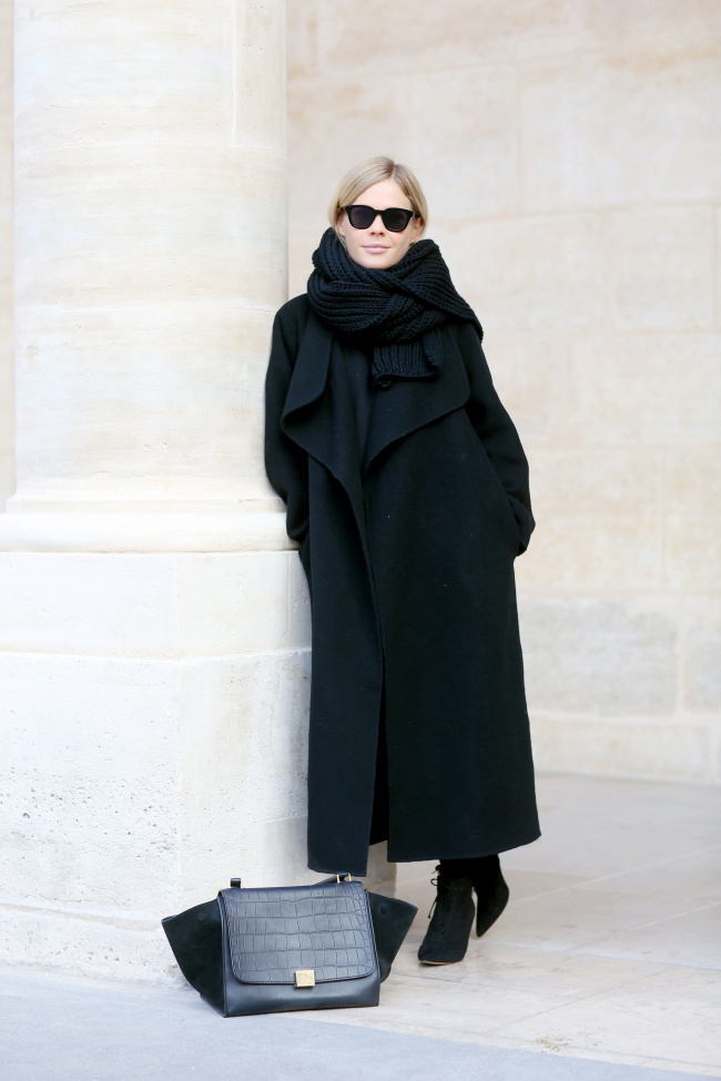 Jessie Bush combines the all-black trend with the maxi coat trend, in this gorgeous ankle length wrap coat and an oversized knit scarf. We recommend this look for any occasion, whether it be every day leisure wear or for work! Brands Not Specified.