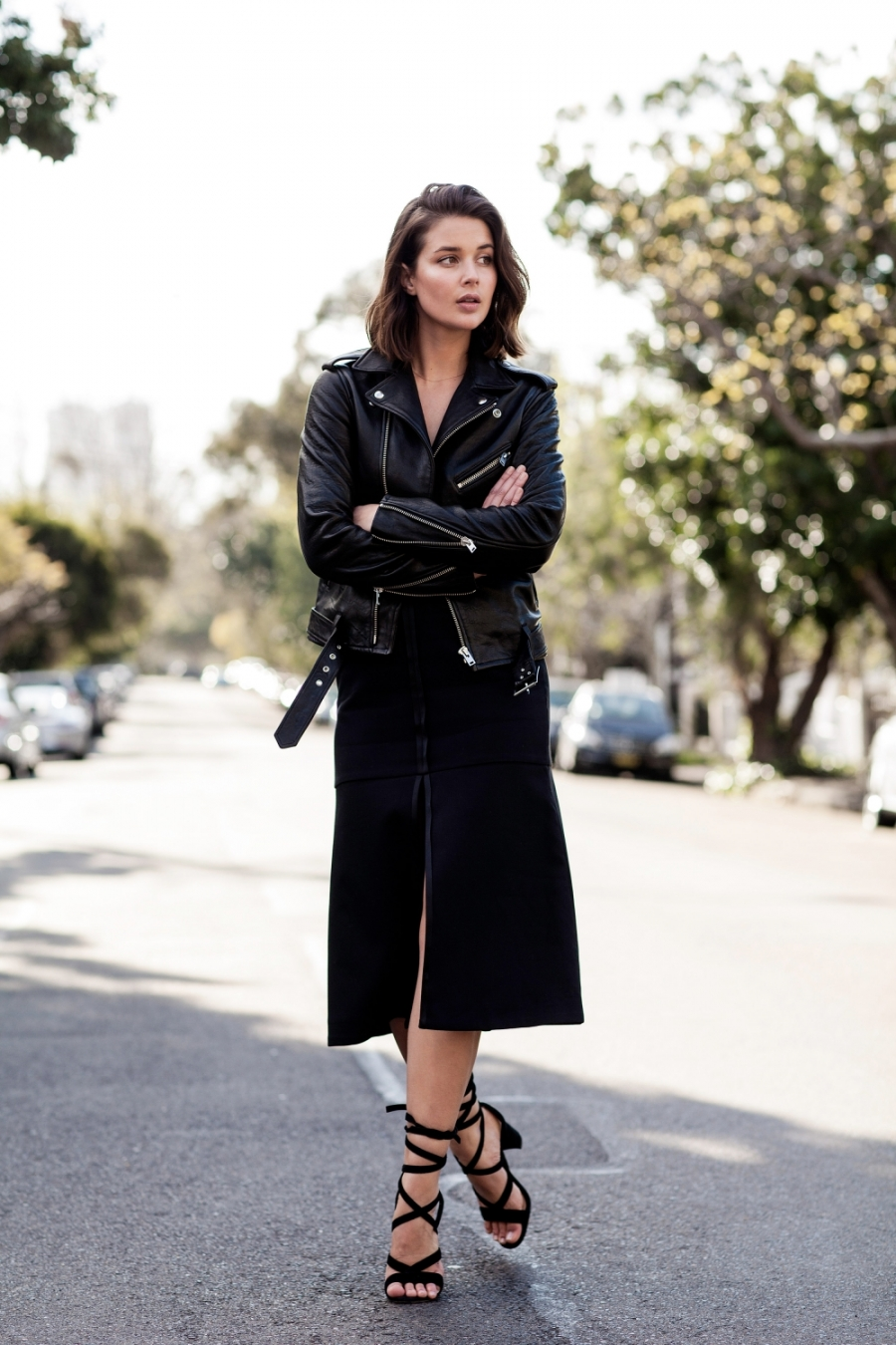 This leather jacket goes perfectly with strappy sandals and a black skirt.Via Sara Donaldson. Leather jacket: IRO.