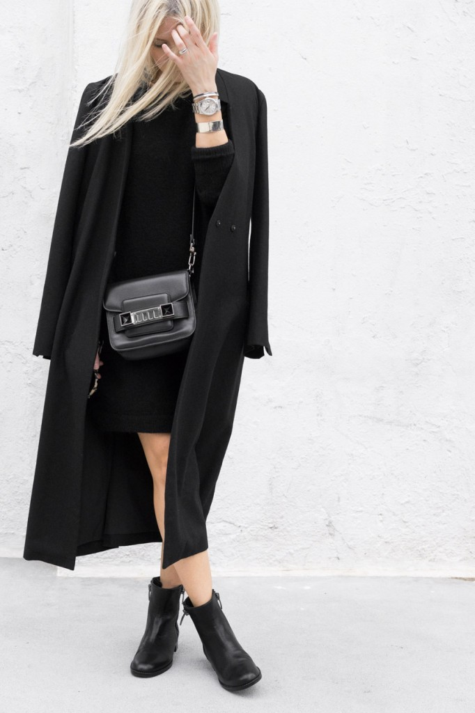 This oversized black coat looks ultra sophisticated when paired with a black mini dress and chelsea boots. Via Figtny. Coat: Third Form, Dress: Aritzia, Ankle Boots: Shoes.com.
