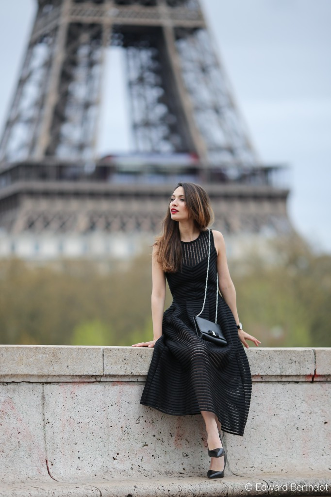 Sofya Benzakour is wearing a black dress from Maje, shoes from Zara and the black bag is from Salvatore Ferragamo from Photography by Edward Berthelot