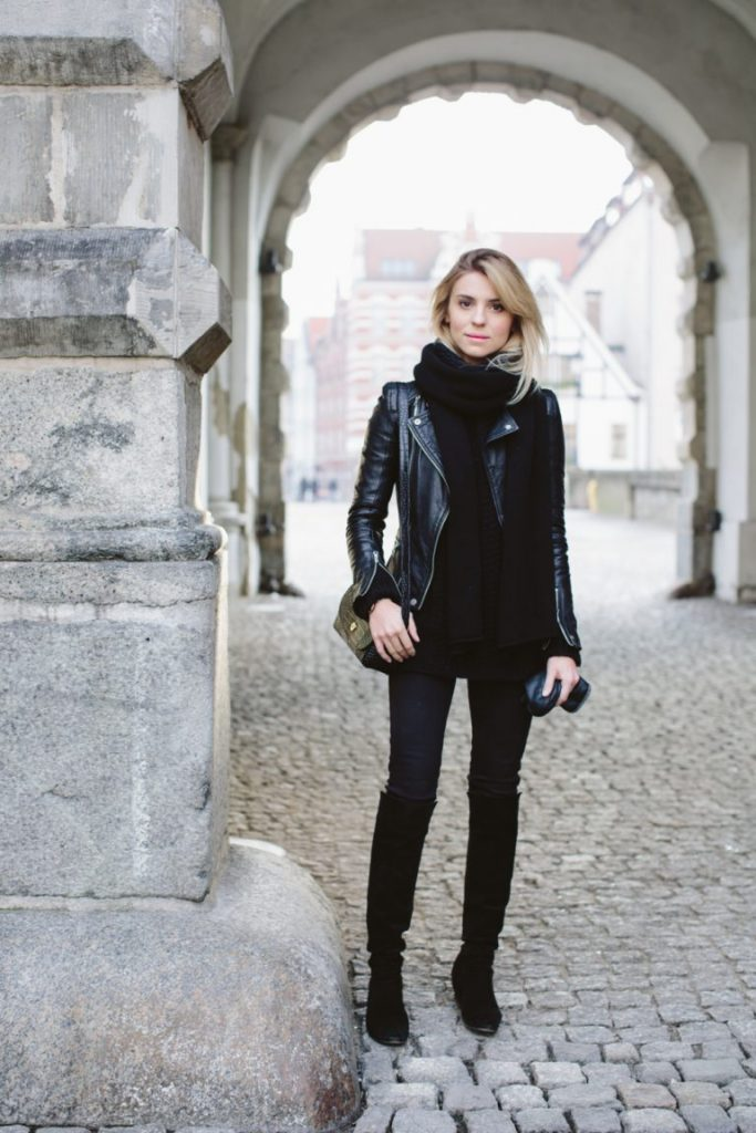 Leather jackets will always make the perfect addition to an all black outfit. Paired with over the knee boots, black jeans and an oversized scarf, Katarzyna Tusk's leather jacket adds just the right amount of glam. Bag: & Other Stories, Jacket/Boots: Zara, Trousers: Topshop.