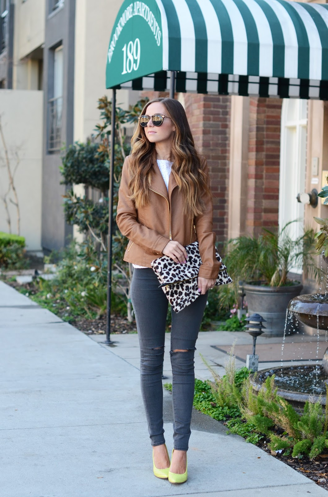 Merricks Art is wearing a beige Asos jacket with dark grey DSTLD denim jeans and Chartreuse lime green heels