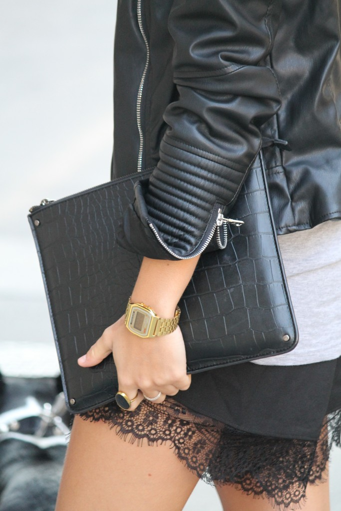 Just The Design: Camille Callen is wearinga black leather jacket with lace shorts from Sheinside and a gold Casio watch