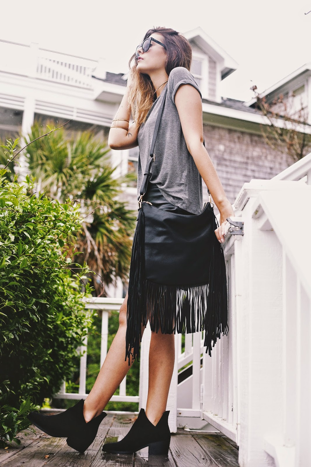 Just The Design: Danielle Dehardt is wearing a grey Forever 21 top paired with an Anti Kraft leather fringed bag and black booties
