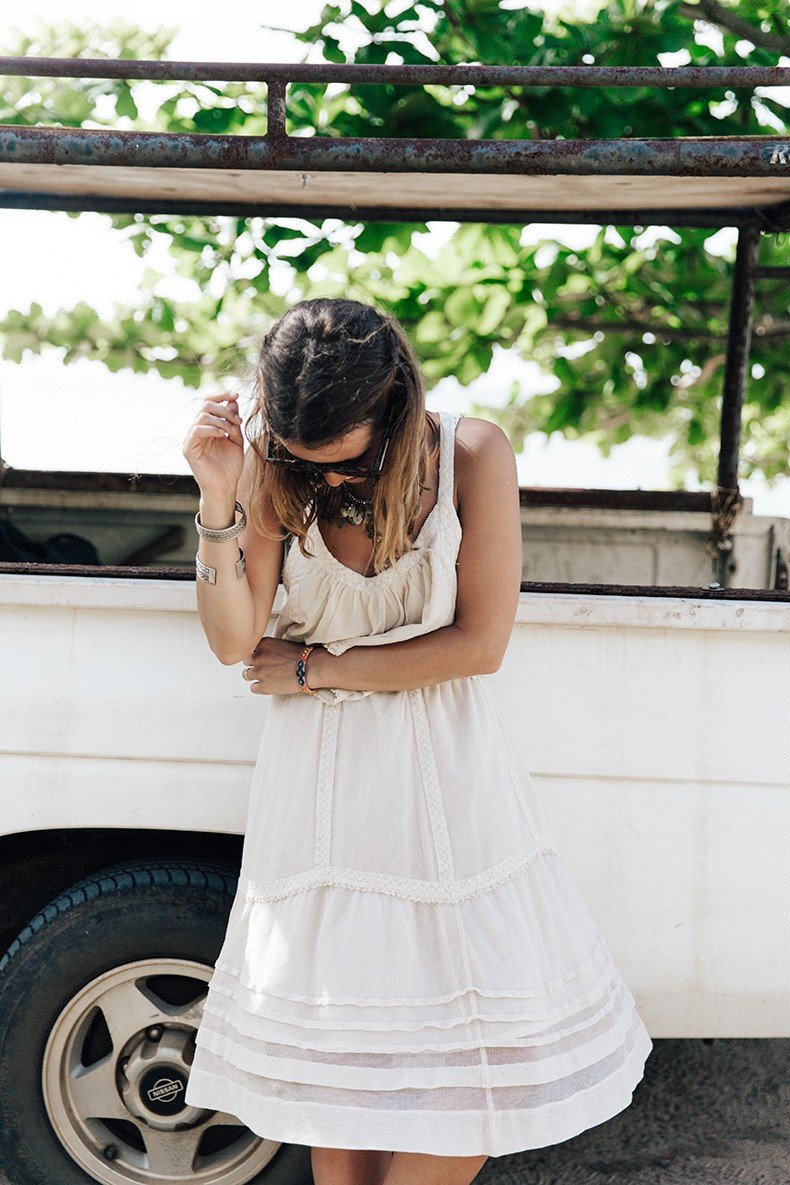 Sara Escudero is wearing a white top and skirt from Free People