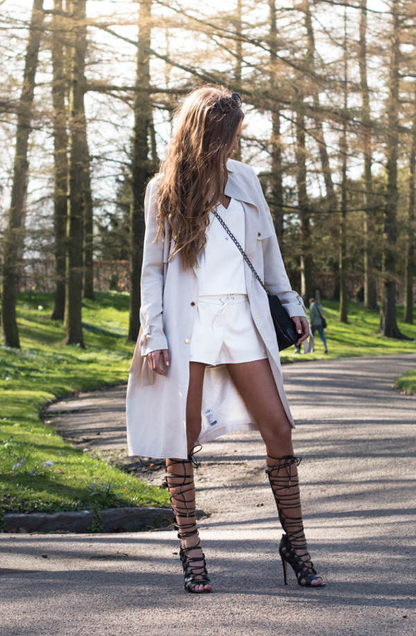 Sandra Willer is wearing white top and skirt from Gina Tricot, and the high lace-up shoes are from JustFab