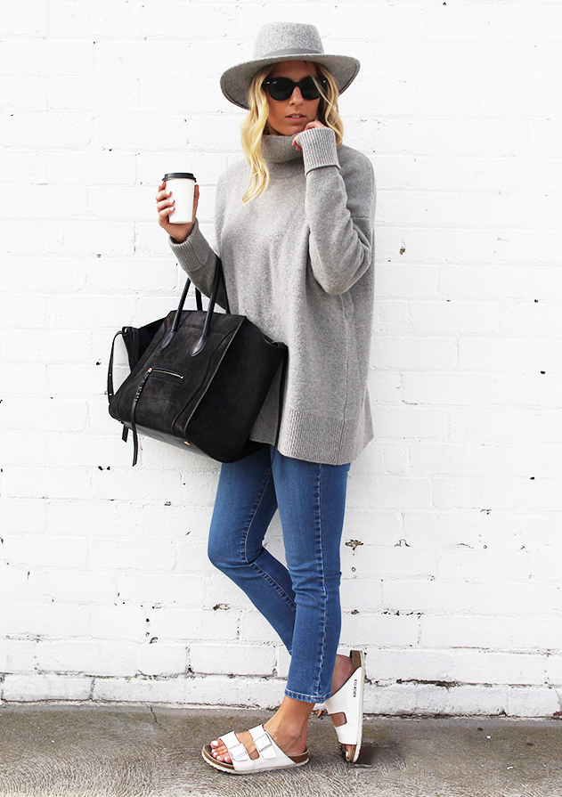 Lisa Hamilton is wearing a suede bag from Celine, grey turtleneck sweater from Whistles, jeans from Nobody, hat from Ace of Something and the sandals are from Birkenstock