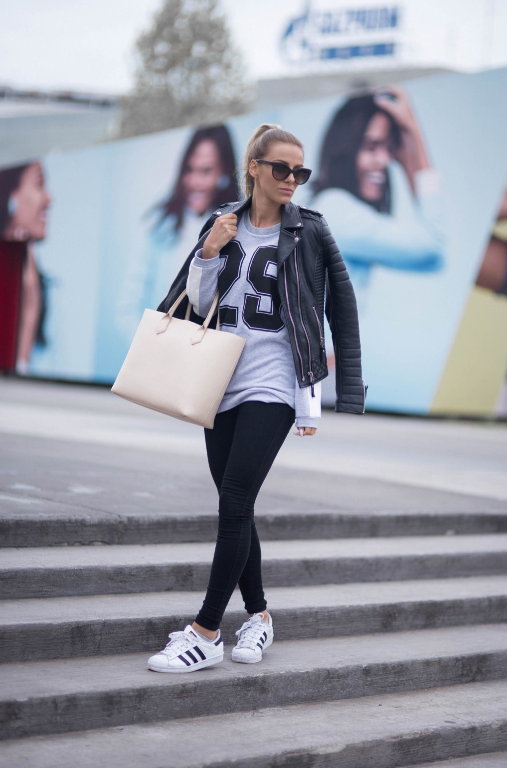 Sendi Skopljak is wearing a jacket from Boda Skins, sweater from Rut & Circle, black denim leggings from Dr Denim and the shoes are from Adidas