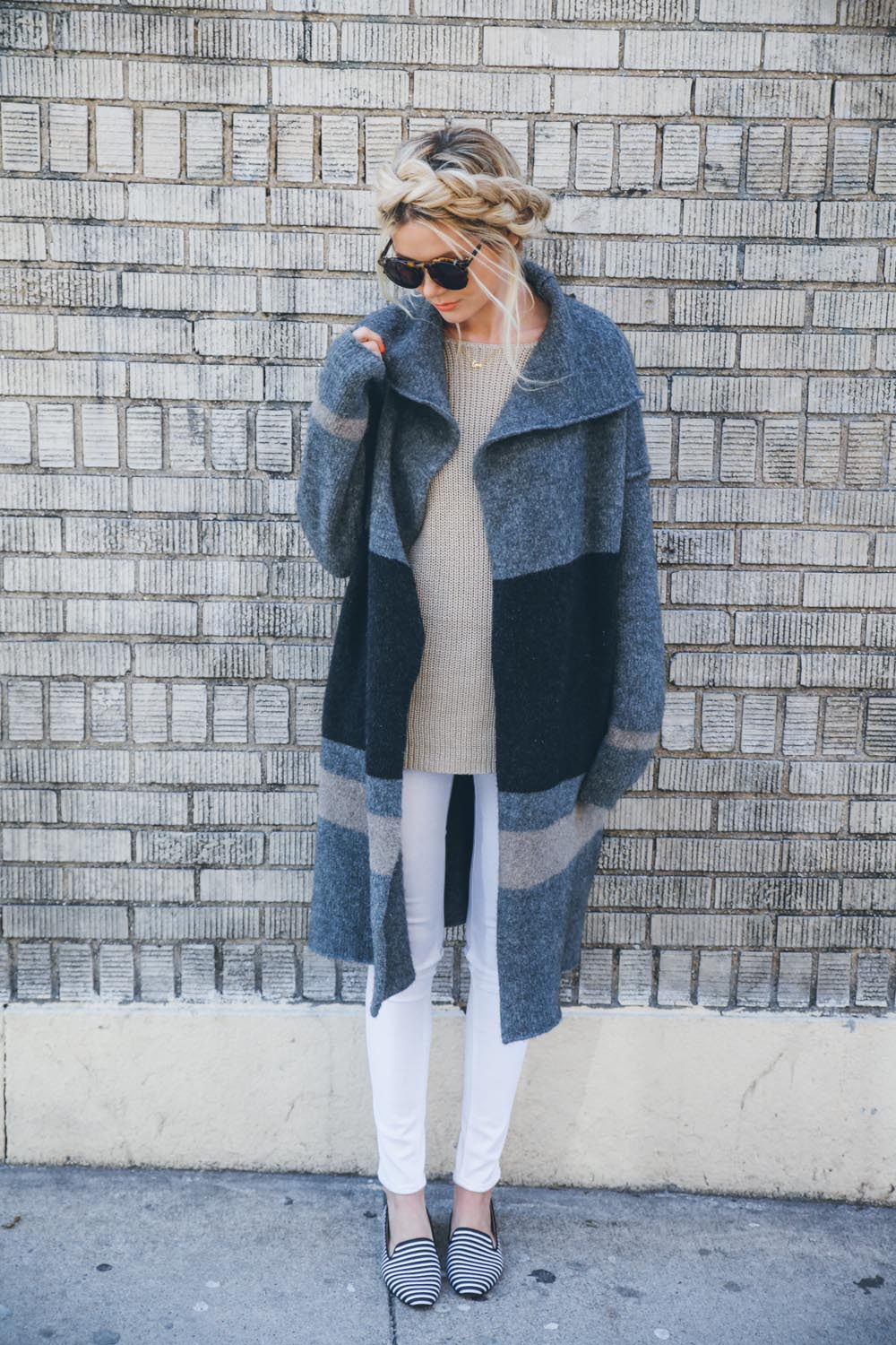 Amber Fillerup Clark is wearing striped shoes from Sole Society, jeans from Rag & Bone and a sweater from James Perse