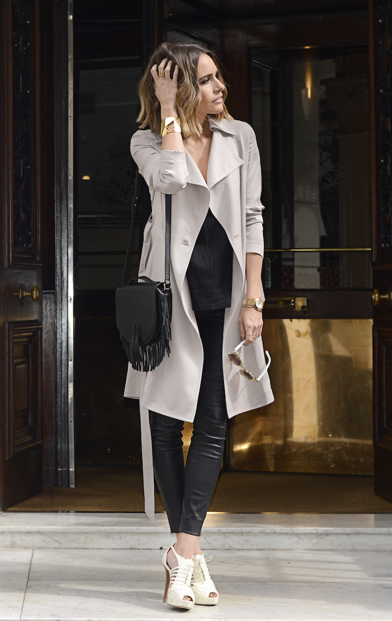 Louise Roe is wearing a classic trench coat from Reiss, black leather trousers from Ralph Lauren, sunglasses from Poppy Lissimann, bag fromMeli Melo and the shoes are from Ralph Lauren
