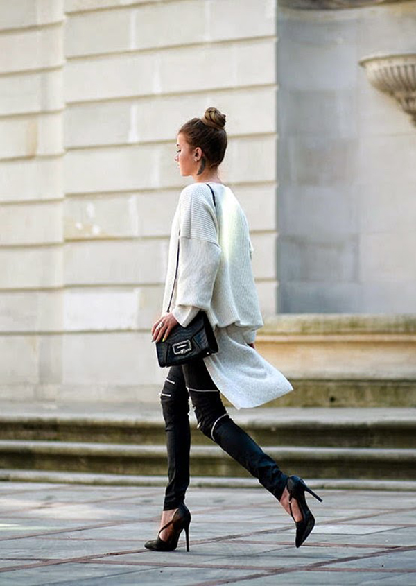 Julietta Kuczyńska is wearing a white top and black shoes from Zara, the white cape is from Viola Wołczyńska, bag from Sabrina Pilewicz and the leather trousers from Denimbox