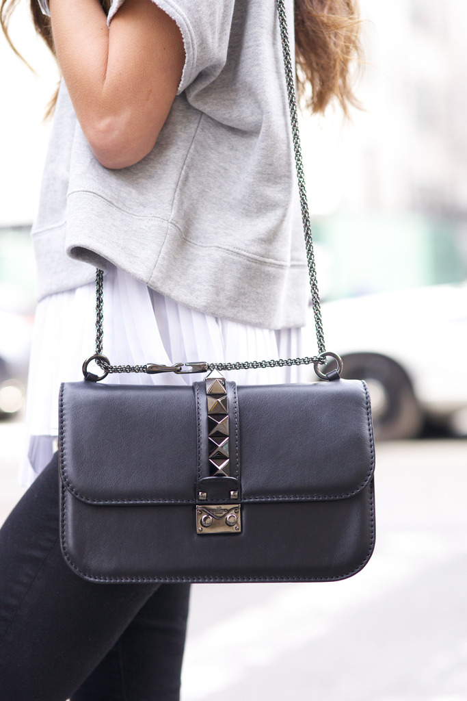 It is all about the bag, isn't it? This is the black and gunmetal rockstud chain mini lock bag from Valention Via Arielle Nachami