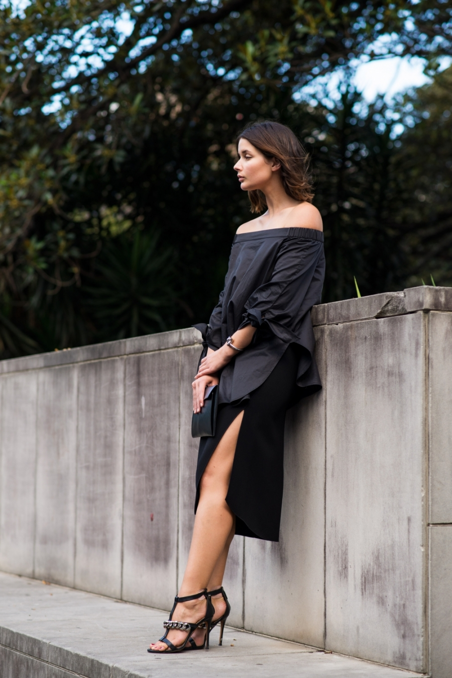All Black Outfit With Heels: Sara Donaldson is wearing a Tibi over the shoulder black top with a Dion Lee skirt and Givenchy heels