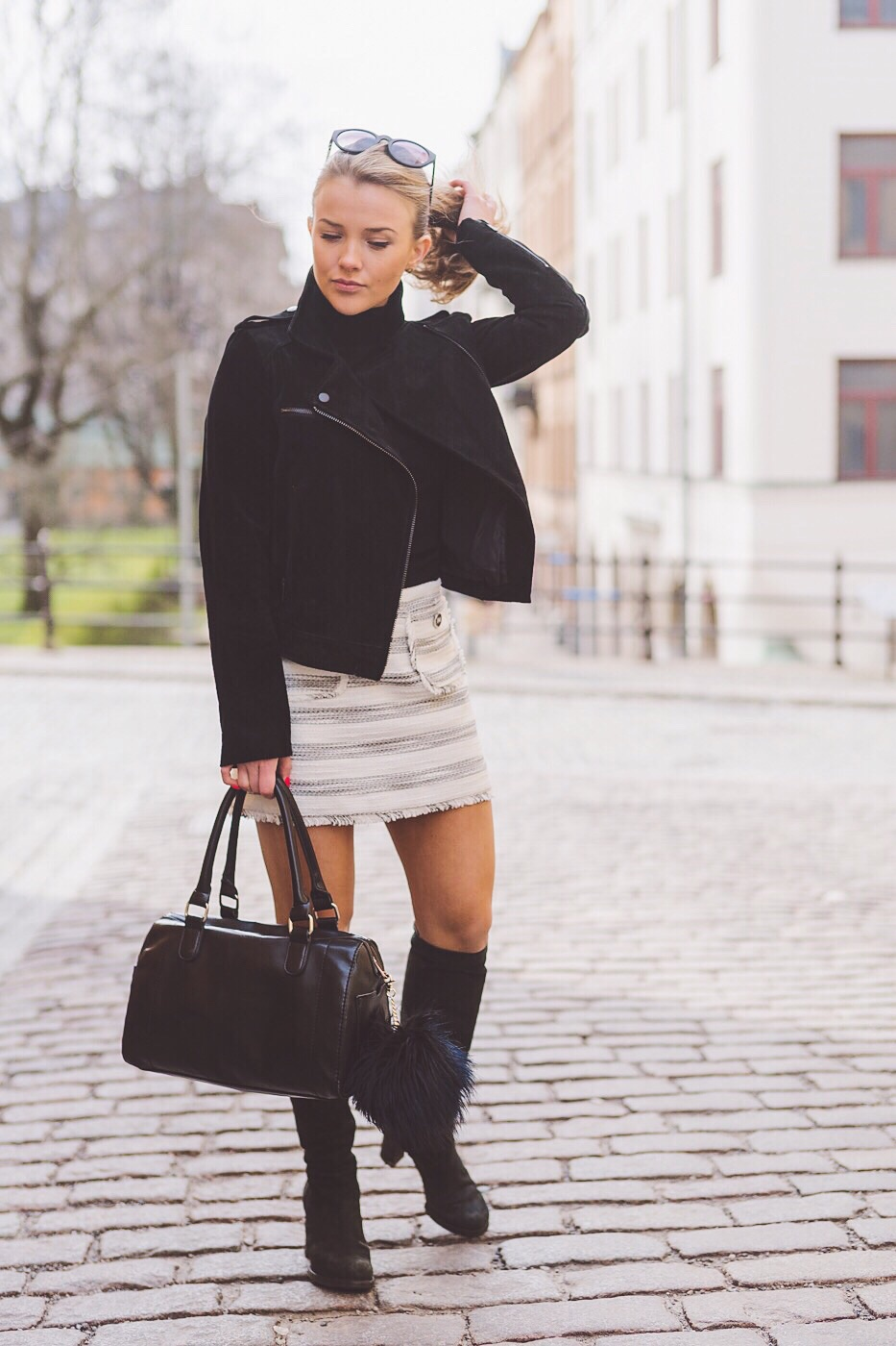 Street Style, Fashion 2015: Molly Rustas is wearing a creme River Island skirt with a jet black biker jacket and leather handbag from Mango