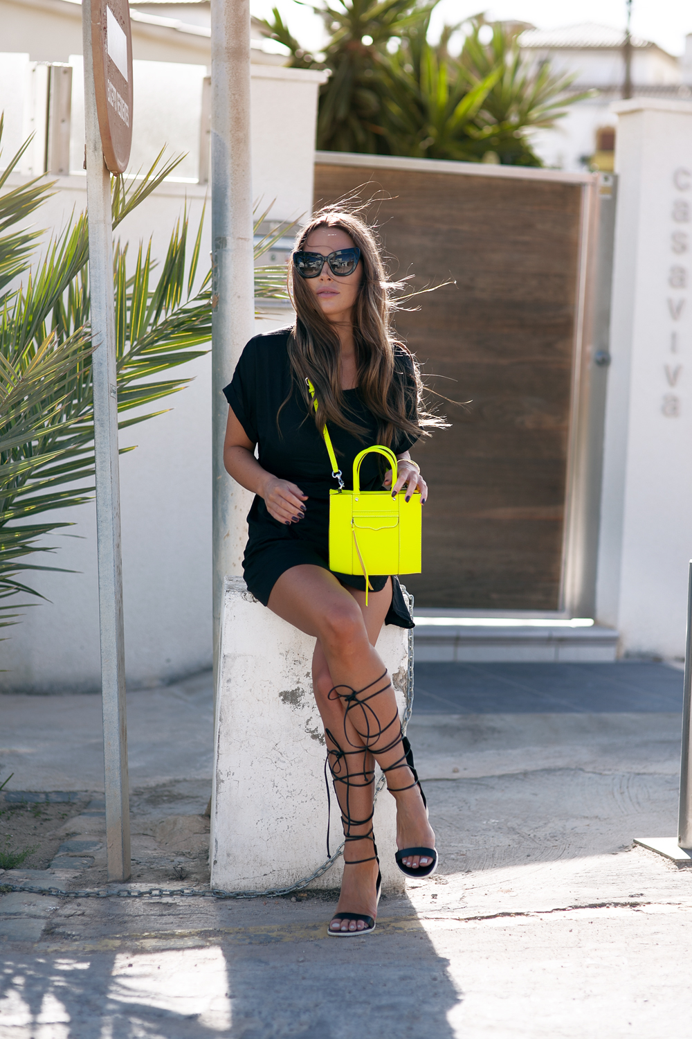 Johanna Olsson is wearing black lace up Tibi sandals with a Lindex dress and a neon Rebecca Minkoff sidebag