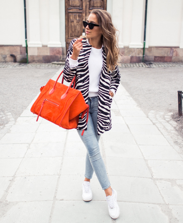 Street Style, April 2015: Kenza Zouiten is wearing a zebra print coat with Acne denim jeans and white Adidas Airforce sneakers