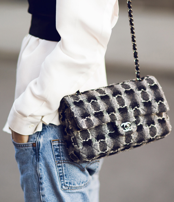 Just The Design: Pernille Teisbaek is wearing a pair of denim light wash mom jeans with a Chanel clutch handbag