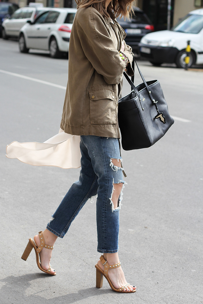 Street Style Fashion For April: Vanja Milicevic is wearing beige studded heels, distressed jeans and a khaki green jacket all from Zara with a Trussardi black handbag