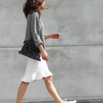 Annemiek Kessels is wearing a knitted sweater and bag from Zara, Adidas sneakers and a H&M white midi skirt