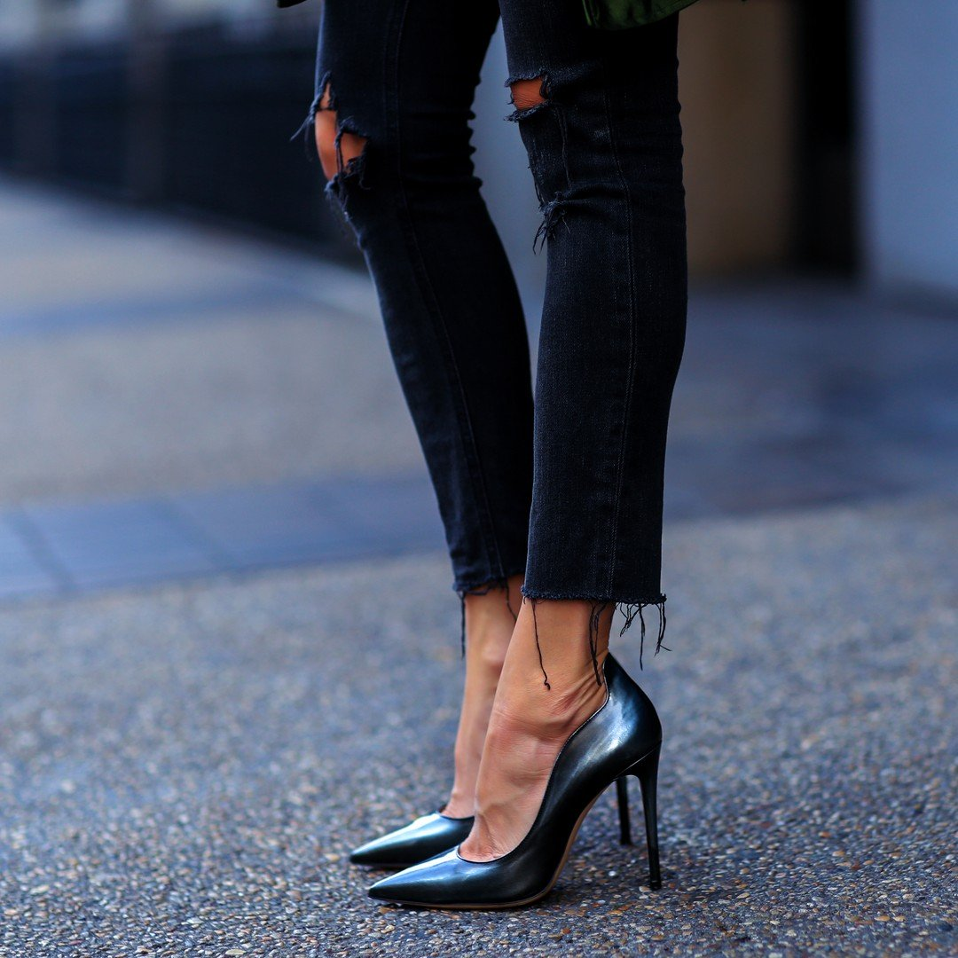c7039bfdda09 Erica Hoida wears sophisticated stilettos with frayed black jeans with  ripping detail. This look is