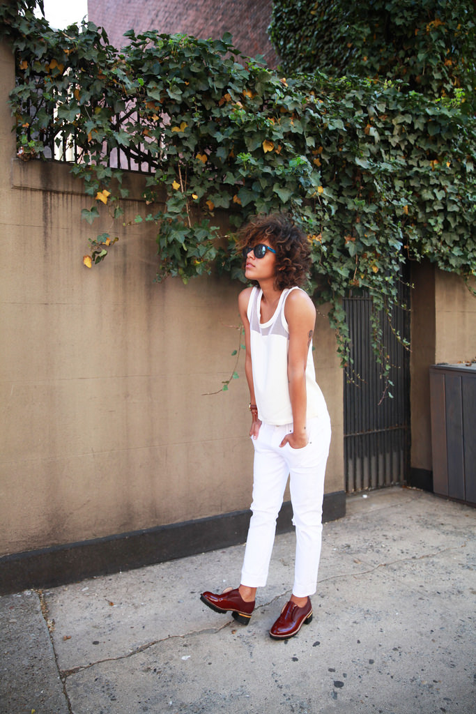 Christina Caradona is one of the ultimate tomboy style bloggers. Here is seen wearing a white top and jeans and burgundy men's shoes Top: Edun, Jeans: A Gold E, Shoes: Mamut