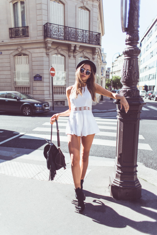 Bohemian Style Essentials: Kenza Zouiten is wearing a Chicy.se jumpsuit, Jeffery Campbell ankle boots and a fringed black backpack