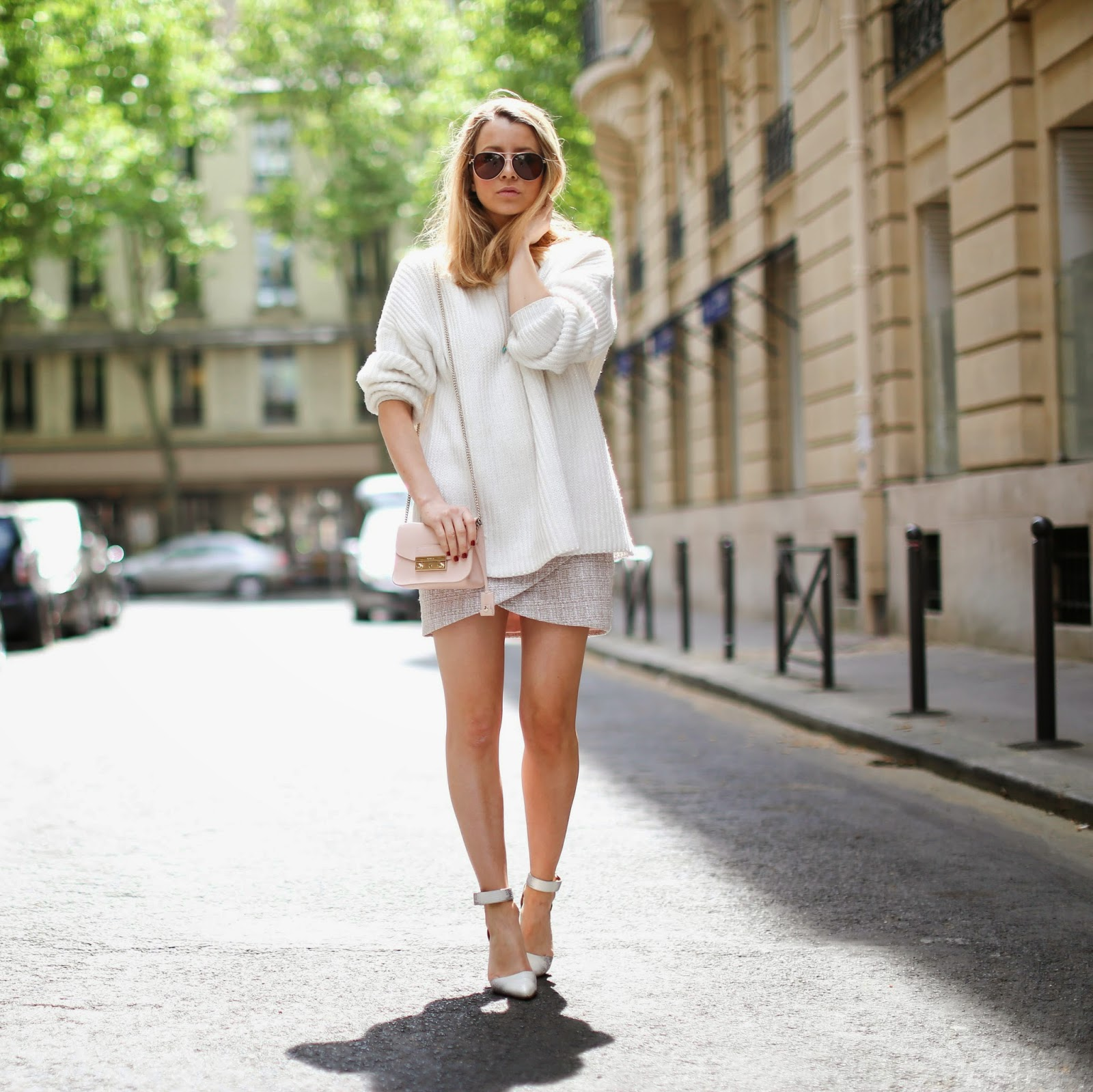 bd1624f53d8 Caroline Louis is wearing a creme knitted sweater with a mini skirt