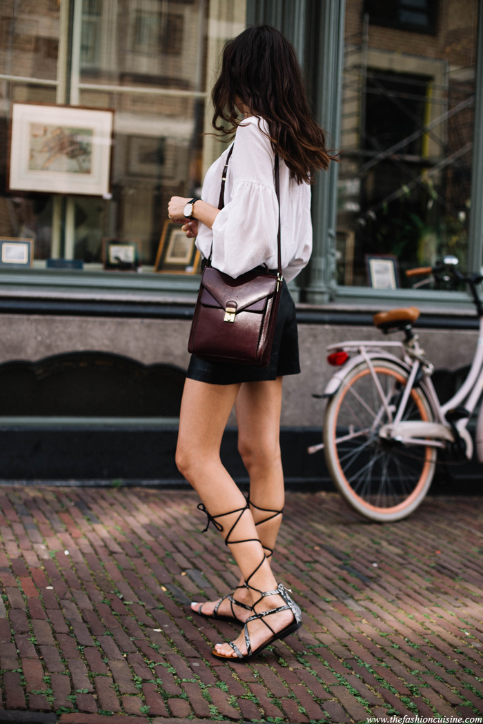 90ccc008274 We love the way Beatrice Gutu has paired these gladiator sandals with a  contrasting black shorts and a white blouse!