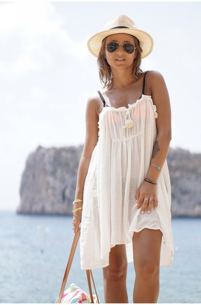 52da8cd2d944d 30. beach · Camille Callen's is wearing sheer coverup dress over a bright  bikini.