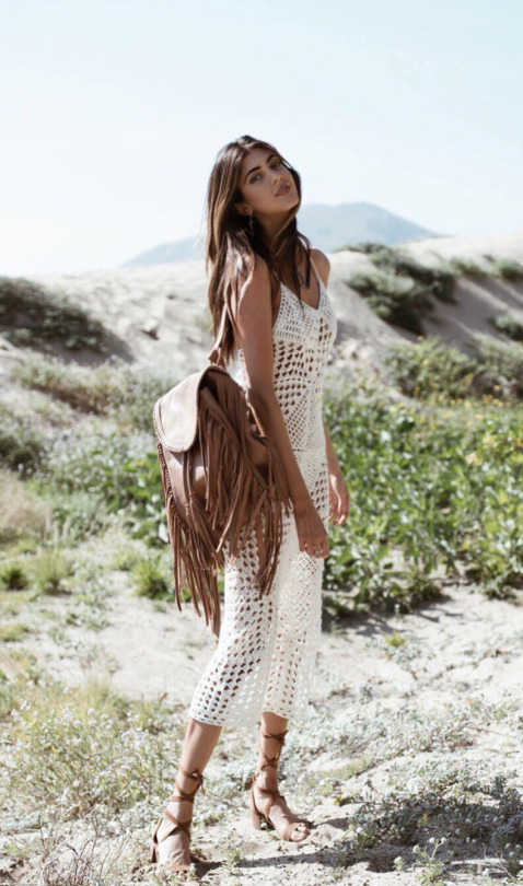 A dress like this with holes and cut out detailing is a great way to cover up at the beach without losing your beach chic! Kelsey Taylor White wears this stylish piece over a bikini and with gladiator sandals. Dress: Indah, Bag: Cleobella, Shoes: Steve Madden.